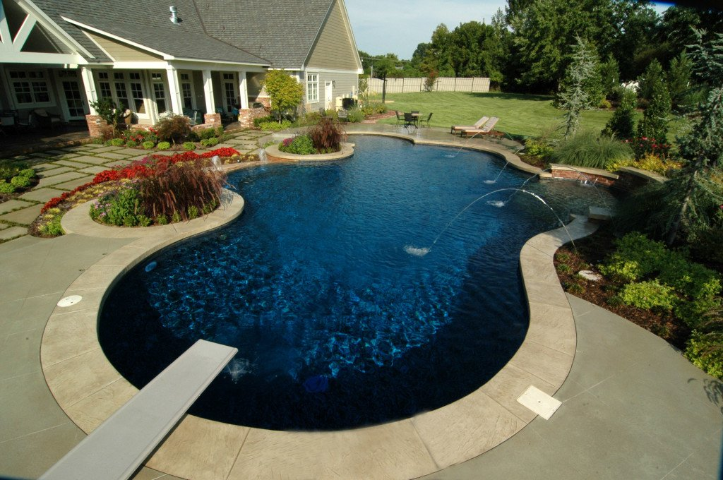 With a diving board, deep and shallow zones and deck jets, this swimming pool makes the ultimate staycation spot!